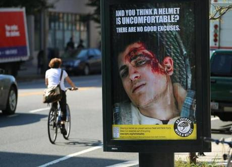 "This scary sign is part of the city's $40,000 ""Wear a Helmet"" campaign."